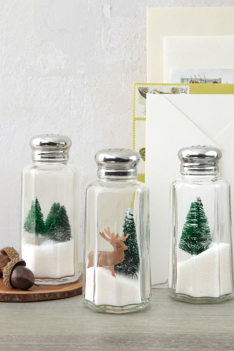 "Here's one Yuletide idea that's definitely worth its salt: Turn under-a-dollar shakers into mini winter wonderlands by nesting toy evergreens and deer atop iodized ""drifts."" What you'll need: salt shakers ($13 for 12, amazon.com); mini trees ($12 for pack of 24,amazon.com); reindeer ($1.67 for six, hobbylobby.com)"