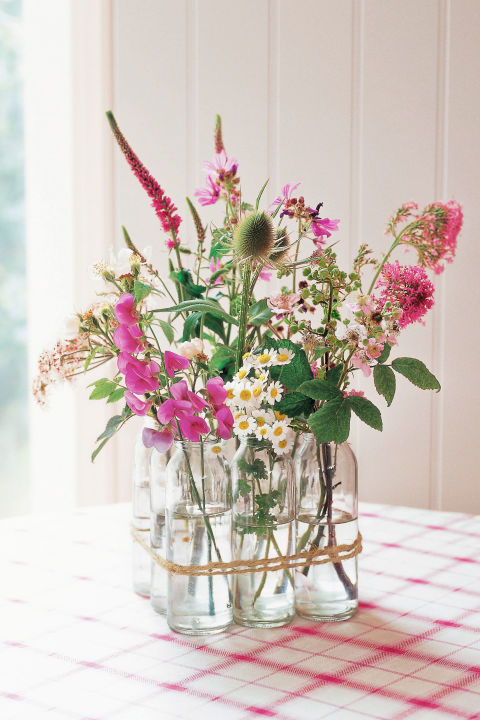 This arrangement—featured in Decorating with Flowers by Paula Pryke—gets its charm from vintage milk bottles tied together with gardener's twine.