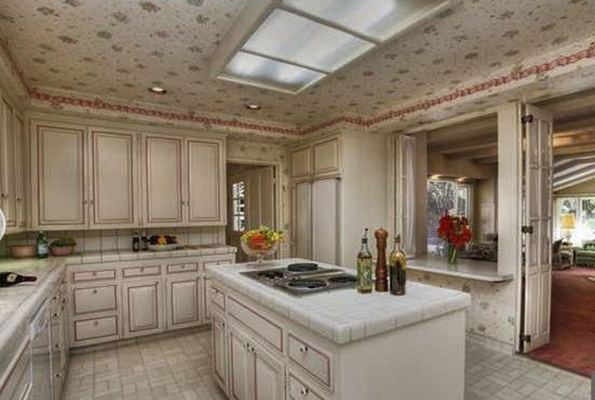 The kitchen in this California bungalow had some interesting decorative (and dated) touches.