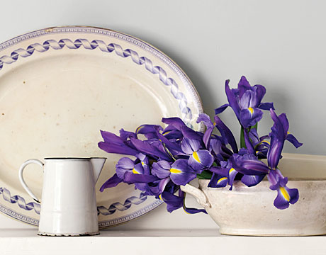 Irises, laid gently on their side in an ironstone tureen, become an insouciant display. Any favorite orphaned vessel--you might also try a compote dish or a favorite porcelain teacup on a stack of like-sized saucers--can be put to enchanting use holding flowers cut from the garden. For the most memorable effect, choose blossoms that pick up the colors in your china.