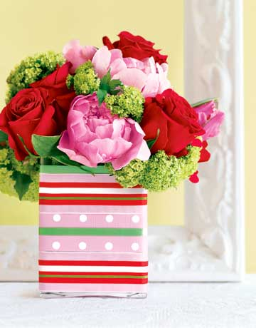 Cluster pink peonies and tulips, red roses, and chartreuse verbena in an oversized square vase wrapped in striped and polka-dotted ribbons. Hot-glue the backs of the ribbons and adhere them to the vase (or substitute heavy-duty double-faced tape).