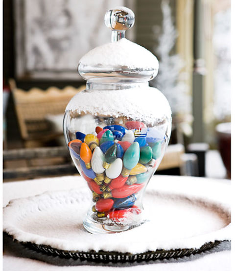 Brighten a room with colorful bulbs. Even unplugged lights shine when gathered in a glass apothecary jar. For a container that truly glistens, top it off with a dusting of artificial snow.