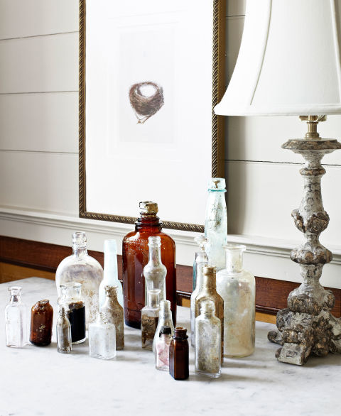 Old bottles unearthed on the property are displayed in the living room. Plus: 38 ways to make something new out of something old »