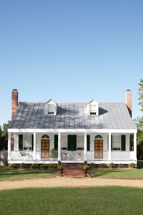 The Thomases knew that their 1820s home was about to be brought back to life. The couple already had big plans to transform Laurietta, as the Fayette, Mississippi, plantation is known, from a dilapidated buzzard's nest into a roost where their extended family—four grown children, plus their spouses and eight kids—could come together for weekends and holidays. In this photo: The couple rebuilt both chimneys and added a hand-crimped aluminum roof. Plus: Our ultimate guide to kitchen design »