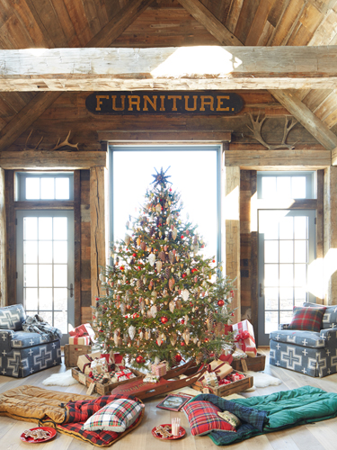 "Kids will love this idea: Add cozy sleeping bags for ""campouts"" under the Christmas tree.  RELATED: A Homespun Christmas in a Cozy Connecticut Farmhouse"